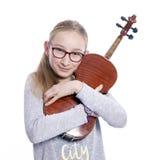 Caucasian teenage girl wears glasses and hugs violin stock photos