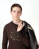 Caucasian teenage holding leather jacket Royalty Free Stock Images