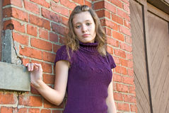 Caucasian teenager girl by brick wall stock image