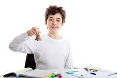Caucasian Teenager ringing bell homework Stock Photo