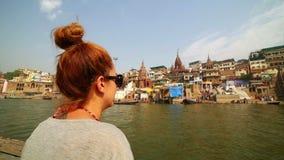 Caucasian tourist girl, indian boat, varanasi ganges river, india Stock Image