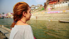Caucasian tourist girl, indian boat, varanasi ganges river, india Royalty Free Stock Photography