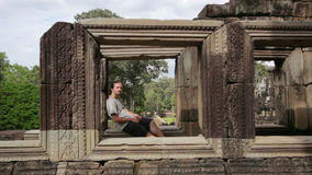 Caucasian tourist travel in baphuon temple looking camera, angkor, cambodia Stock Image