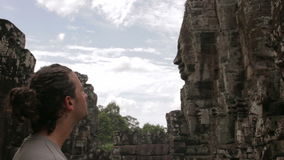 Caucasian tourist travel in bayon temple, angkor, cambodia Royalty Free Stock Image