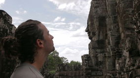 Caucasian tourist travel in bayon temple, angkor, cambodia Royalty Free Stock Photography