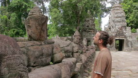 Caucasian tourist travel in preah khan temple, angkor, cambodia stock footage