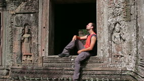 Caucasian tourist travel in preah khan temple, angkor, cambodia stock video footage