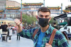 Caucasian tourist using pollution mask in Asia.  royalty free stock photography