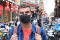 Caucasian tourist using pollution mask in Asia.  royalty free stock image