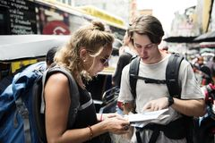Caucasian tourists couple checking on the map stock photography