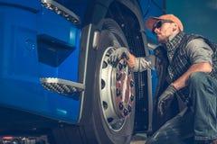 Truck Driver Checking Tires stock photos