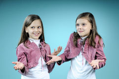 caucasian twins making conversation Royalty Free Stock Image