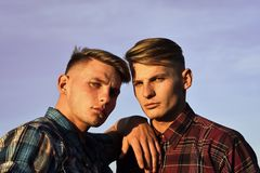 Caucasian twins in shirts with serious faces royalty free stock image