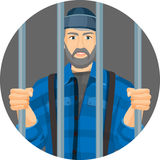 Caucasian unshaven man behind bars in round button isolated on white Royalty Free Stock Images