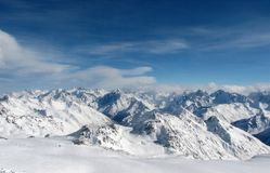 Caucasian view. Sky and Snow. Caucasian mountains from the Mt Elbrus. Russia Royalty Free Stock Photography