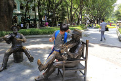 Caucasian violinist bronze sculpture. Caucasian violinists bronze sculptures in shamian scenic, guangzhou city, china. here was once western powers concession Royalty Free Stock Photo
