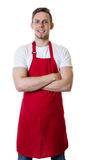 Caucasian waiter with red apron and crossed arms Royalty Free Stock Images