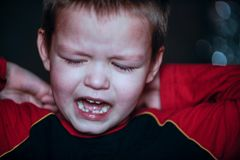 Caucasian white little boy crying with tears portrait outdoor Stock Images