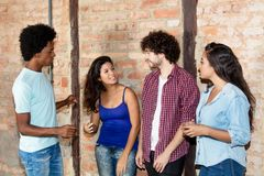 Caucasian woman and african man talking with latin american youn stock photography