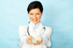 Caucasian woman as a doctor holding meds Royalty Free Stock Image