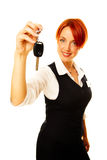 Caucasian woman as hotel worker offering key Stock Photography