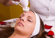 Caucasian woman at the beautician. Royalty Free Stock Photo