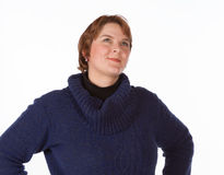 Caucasian woman in blue and red. Caucasian woman in a blue jersey and red trousers on a white background stock photos