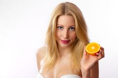 Caucasian woman with bra holding orange Royalty Free Stock Photos