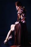 Caucasian woman with  brown elegant dress Stock Photos