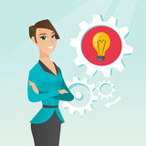 Caucasian woman with business idea bulb in gear. Young caucasian business woman having a creative idea. Happy business woman with business idea lightbulb in a Stock Photography