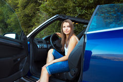 Caucasian woman in a cabriolet Stock Images