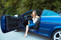 Caucasian woman in a cabriolet Royalty Free Stock Photos