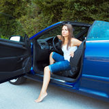 Caucasian woman in a cabriolet Stock Photo