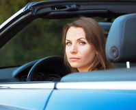 Caucasian woman in a cabriolet Royalty Free Stock Photography