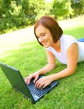 Caucasian Woman Chat On Computer Outdoor Royalty Free Stock Photos