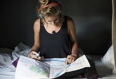 Caucasian woman checking using Bangkok Thailand map stock images
