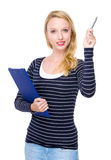 Caucasian woman with clipboard and pen up Stock Photo