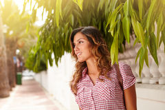 Caucasian woman contemplating while looking away. Caucasian woman with wavy hair contemplating outdoors while looking away - copy space Royalty Free Stock Photos