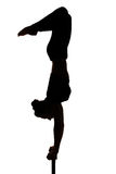 Caucasian woman contortionist practicing gymnastic yoga in silhouette Royalty Free Stock Images