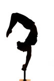 Caucasian woman contortionist practicing gymnastic yoga in silhouette Royalty Free Stock Photography