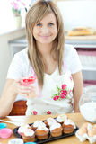Caucasian woman cooking cakes in the kitchen Stock Photography