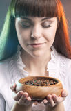 Caucasian Woman with Cup of Coffee Beans Stock Image