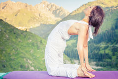 Caucasian woman doing yoga at mountain Stock Images