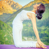 Caucasian woman doing yoga at mountain Royalty Free Stock Images
