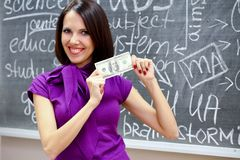 Caucasian woman with dollar note Stock Photo