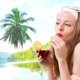 Caucasian woman drinks unrecognizable cocktail Royalty Free Stock Photography