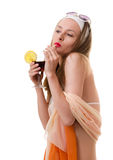 Caucasian woman drinks unrecognizable cocktail Royalty Free Stock Photo