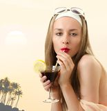 Caucasian woman drinks unrecognizable cocktail Royalty Free Stock Images
