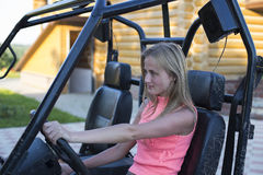 Caucasian woman driving a buggy. Caucasian young woman driving a buggy 4x4 car Royalty Free Stock Photo