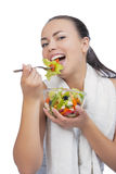 Caucasian woman eating salad Royalty Free Stock Photos